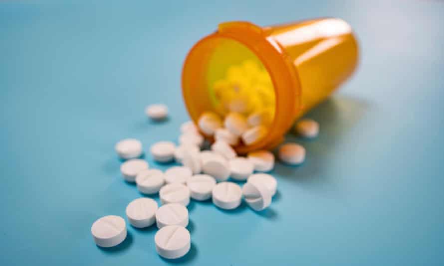 White pills spilling from bottle