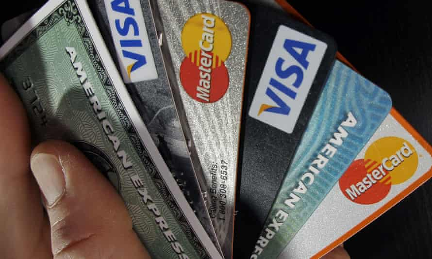 Hand holding a bunch of consumer credit cards