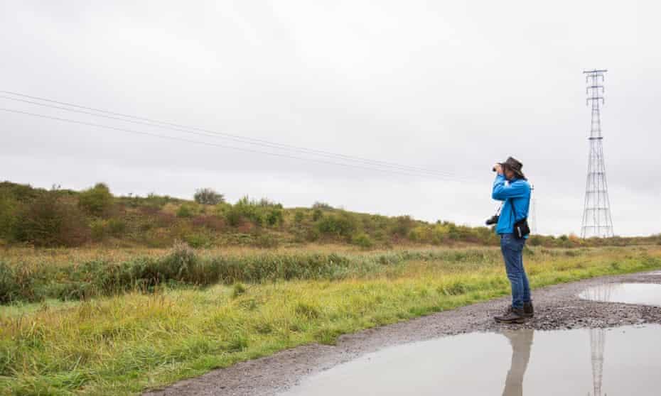 A man looking at nature with his binoculars at Swanscombe Peninsula.