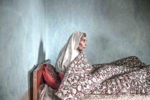 An elderly lady in a bed