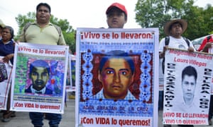 The son of Adan de la Cruz leads a protest over the forced disappearance of 43 students in Guerrero, Mexico