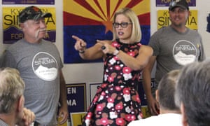 Kyrsten Sinema talks to volunteers at a get-out-the-vote phone bank in Phoenix, Arizona.