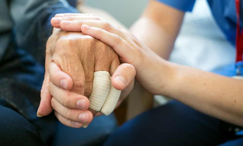 A nurse cares for an elderly patient.