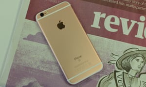 iphone 6S on a copy of the Guardian review