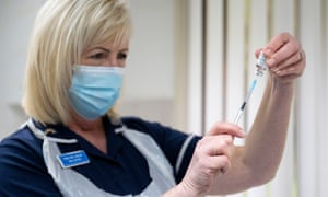 Nurse prepares syringe