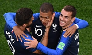 Kylian Mbappé celebrates with Olivier Giroud and Antoine Griezmann after scoring for France against Peru