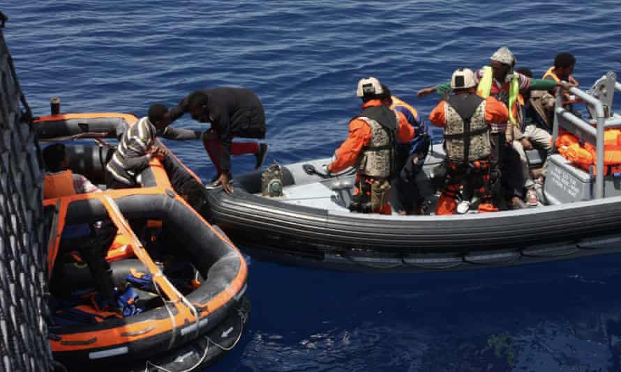 A German frigate rescuing shipwrecked people from the Mediterranean, 130 nautical miles off the Italian island of Lampedusa.