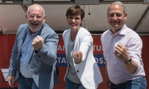 Frans Timmermans (left), the European commission vice-president, celebrates with Party of European Socialists (PES) colleagues from Austria