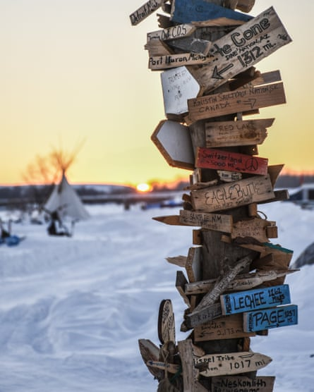 A signpost pointing to home, erected in Fall 2016 by those who came to camp at Standing Rock. It is now on display on the Smithsonian Museum in Washington, DC.
