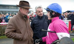 Trainer Willie Mullins, left, and owner Michael O'Leary, centre, have split following a row over training fees.