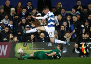 Queens Park Rangers' Jack Clarke hurdles Sheffield Wednesday's Julian Borner at Loftus Road on Friday night. Wednesday won 2-1 as both sides scored in a injury time.