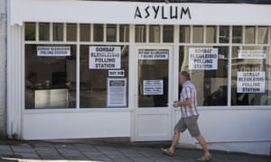 Safe havenA voter arrives at the Asylum Hairdressers polling station in Merthyr, Wales