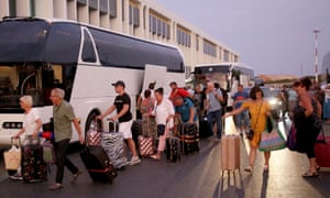 Thomas Cook customers arriving on buses to be repatriated from Heraklion airport, .