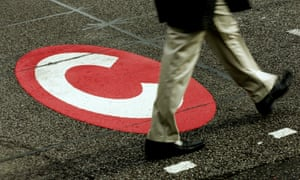 A London pedestrian explores the boundary of the congestion charge zone.