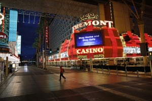 A mans walks along the usually busy Fremont Street after casinos were ordered to shut down,  Las Vegas, California, US