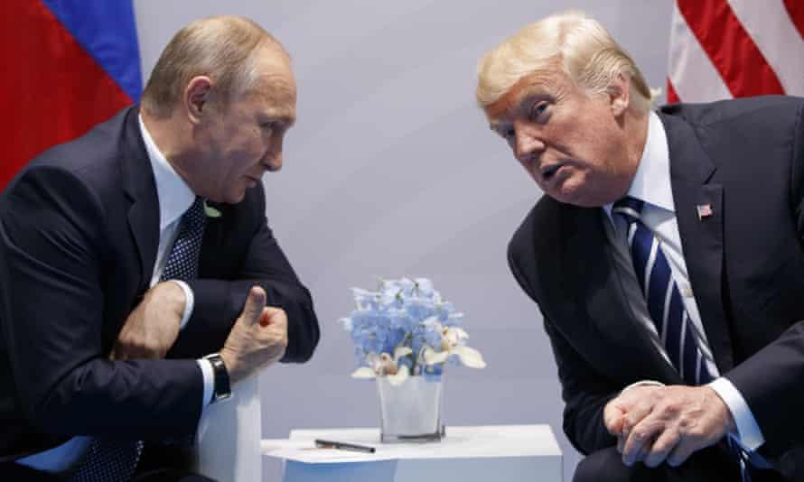 Donald Trump with Vladimir Putin at the G20 summit in Hamburg in July.