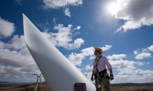 Sturt Daley, site manager, stands atop a wind turbine nacelle at Capital Wind Farm in Bungendore.