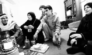 Nofa with family members in the small basement in East-Amman where they live.