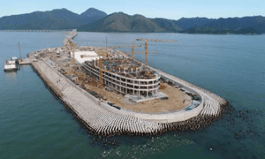 A manmade island which is part of the Hong Kong-Zhuhai-Macau bridge, where wave-absorbing concrete blocks appear to be separated from the protective barrier.