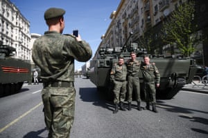 Service personnel pose for a photo in Moscow