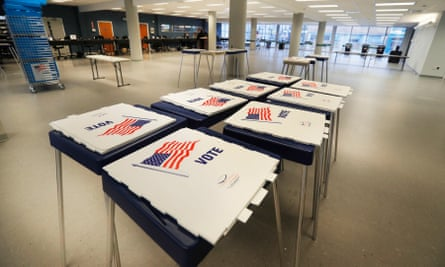 Unused voting stations are taken down in Cleveland after Ohio halted its primary election.