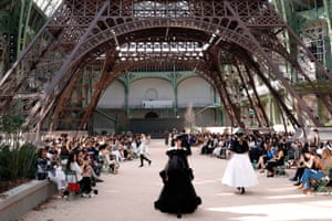 Paris, France: Models present creations for Chanel under a replica of the Eiffel Tower at the Grand Palais during the autumn/winter 2018 haute couture collection