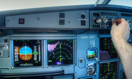A pilot sets the autopilot on an Airbus A320 airliner