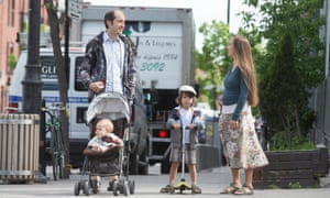 Daniel Goldsmith and Giulia Zaccagnini walk to the park with their children in Montreal.