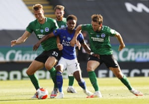 Leicester City's Demarai Gray is crowded out by Brighton's Dan Burn (left) and Shane Duffy.