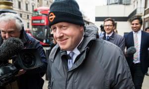 Boris Johnson smiles in woolly hat in central London