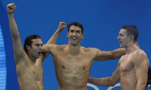 USA's Ryan Murphy, Michael Phelps and Cody Miller celebrate.