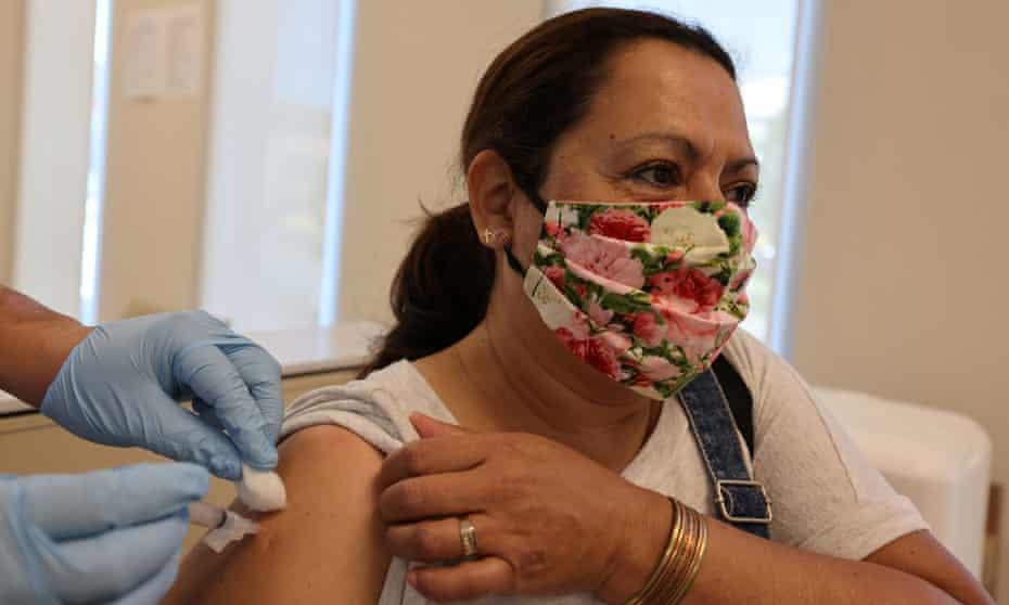 Rosa Hernandez, 56, is given a flu vaccine in East Los Angeles, California Monday.