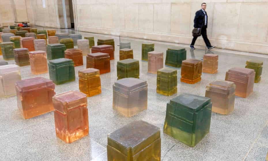 Whiteread's Untitled (One Hundred Spaces) 1995, an installation of 100 casts of the underside of chairs.