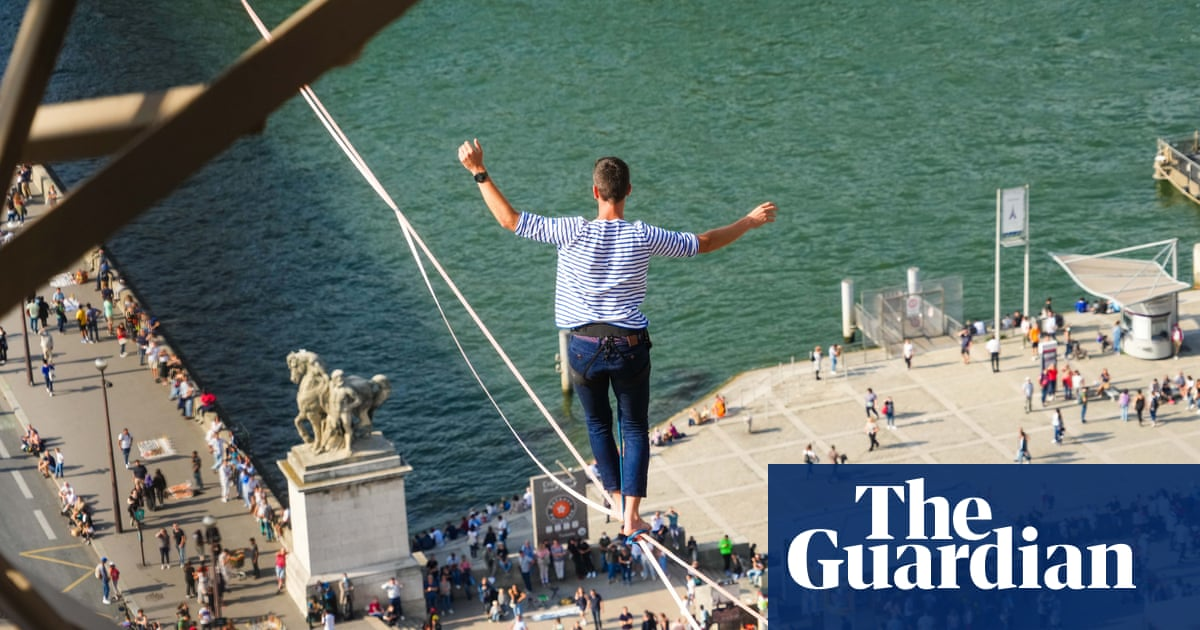 French highline walker makes 600-metre Seine crossing from Eiffel Tower