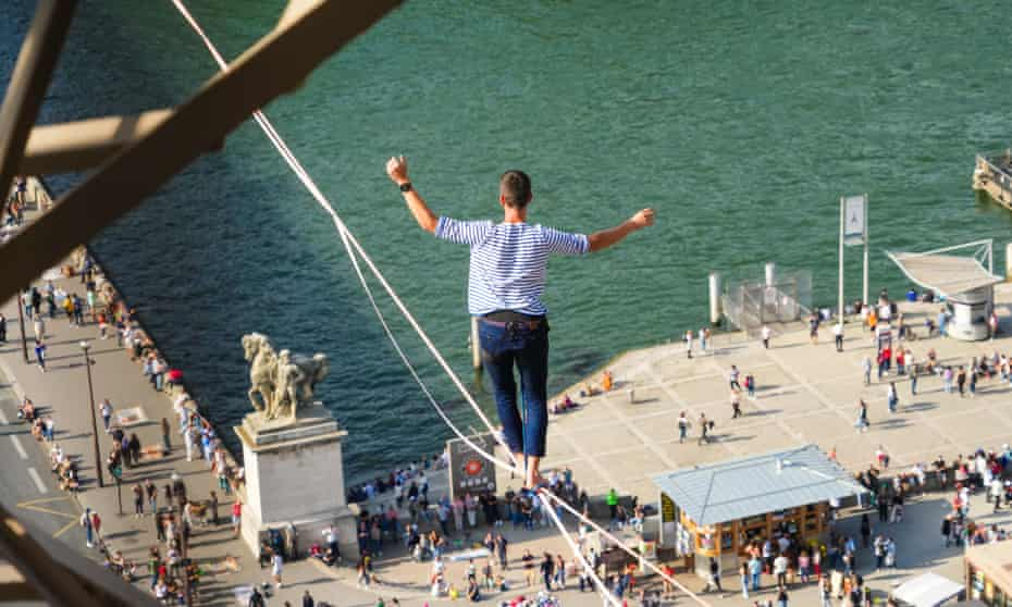 Nathan Paulin traverses a slackline between the Eiffel Tower and the Chaillot theatre in Paris