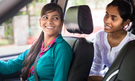 A female taxi driver and female passenger in a car in India as part of Sakha Consulting Wings: Women on Wheels project.