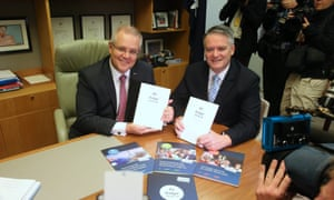 Scott Morrison and Mathias Cormann with the budget papers. A seven-year tax plan is the centrepiece of the 2018 Australian federal budget