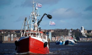 Boats flying pro-Brexit flags sail on the River Tyne during the Fishing For Leave flotilla.