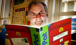 John Cunliffe reading a Postman Pat story to children at a library in Leeds in 2003.