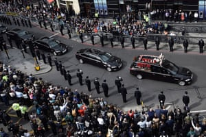Police officers line the route as the funeral procession of PC Keith Palmer makes its way to Southwark Cathedral. PC Palmer was killed in a terrorist attack on the Palace of Westminster, the home of the British parliament.