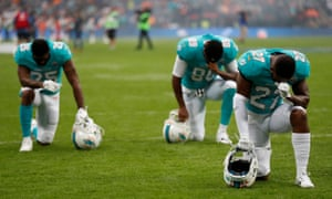 Miami Dolphins players kneel before a match at Wembley stadium in London on 1 October 2017. Trump's response to the NFL anthem protests against racial injustice was: 'Get that son of a bitch of the field.'