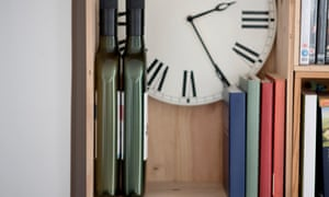 Flat bottles of wine on a bookshelf