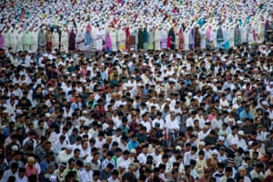 Indonesian Muslims offer Eid al-Fitr prayers at a mosque in Surabaya, Indonesia