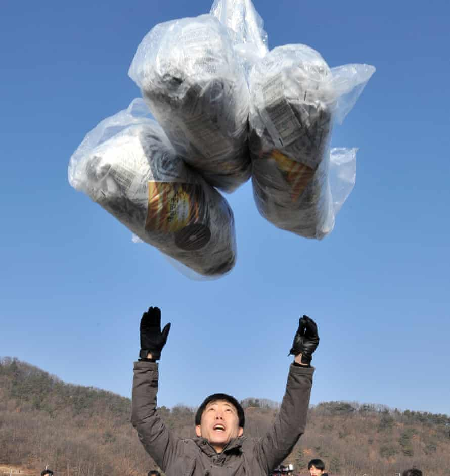 A defector releases a balloon carrying anti-North Korea leaflets at a park in a border town in 2014.