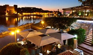 Le Neptune restaurant, Collioure, with sunset over harbour