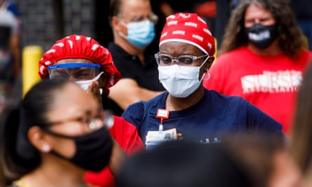 Nurses and doctors at Elmhurst Hospital Center in New York gather for a rally calling for adequate funding of the city's safety net hospitals during the coronavirus crisis.