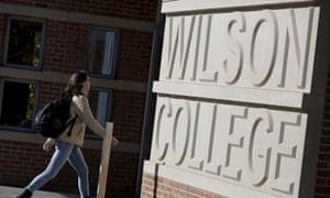 A student walks towards Princeton University's Wilson College.
