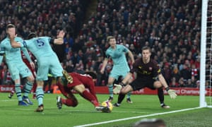 Mohamed Salah falls to the ground after a challenge by Arsenal defender Sokratis Papastathopoulos.