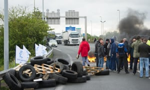 Striking ferry workers burn tyres as they block a road leading to the Channel tunnel.
