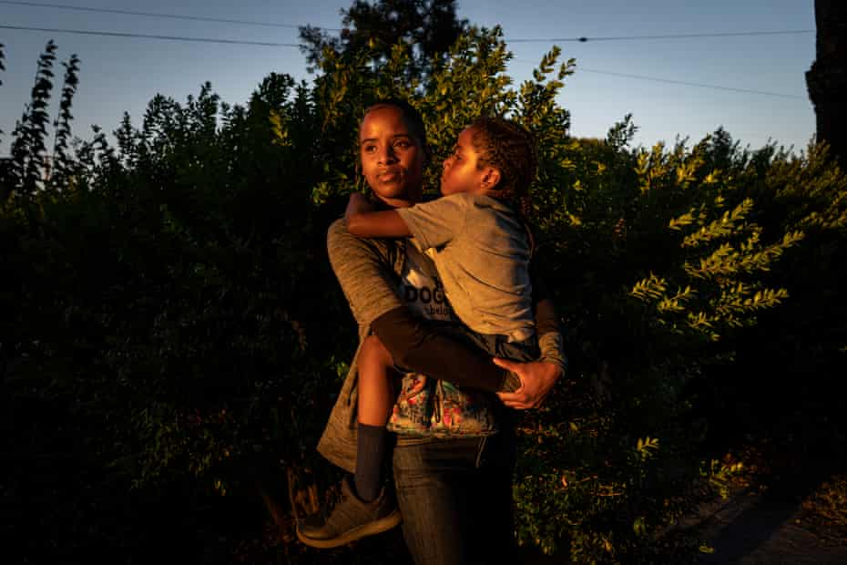 Cherokeena Robinson, 32, with her son Mai'Kel, 7, at the park in Torrance, California. Cherokeena lost her teaching job during the pandemic and now relies on her sister and the organization Family Promise to help with housing, childcare, food and counseling.